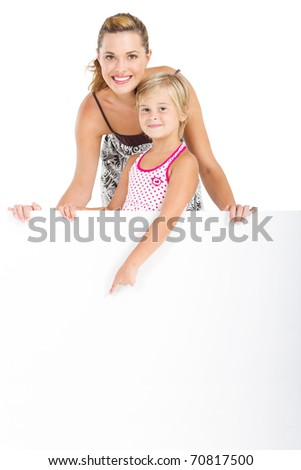 Portrait of an adorable girl and mother holding blank billboard on white background