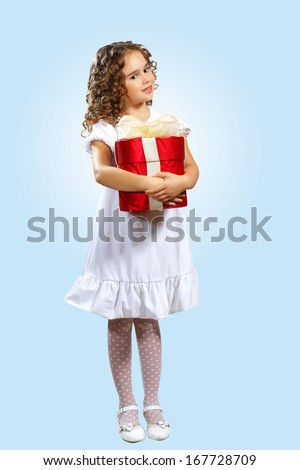 Portrait of an adorable preschool age girl wearing a Christmas holiday outfit