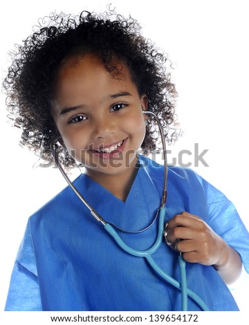 "Portrait of an adorable preschool ""doctor"" in scrubs happily listening to her own heart through a stethoscope.  On a white background."