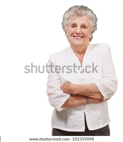 portrait of an adorable senior woman standing over a white background