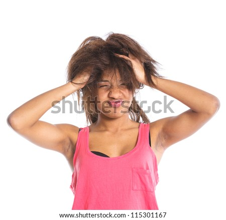 Portrait of an adorable young mulatto grimaces girl. Isolated white backround - stock photo