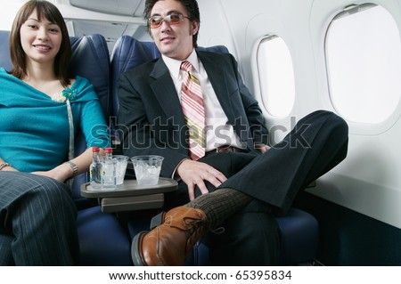 Portrait of an adult couple traveling in an airplane