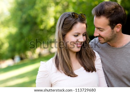Portrait of an affectionate couple flirting outdoors