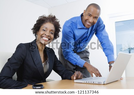 Portrait of an African American business people working together in office