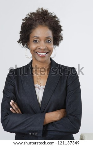 Portrait of an African American business woman with arms crossed isolated over white background - stock photo