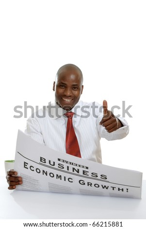 Portrait of an African American businessman reading newspaper sitting at the table