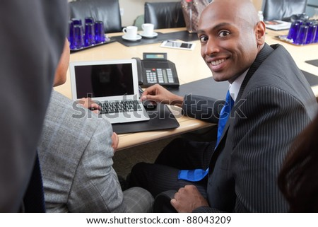 Portrait of an African American businessman working with colleague in office