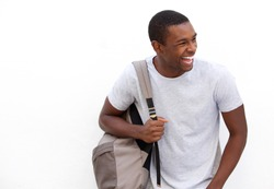 Portrait of an african american college student laughing with bag on white background