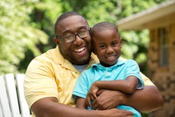 Portrait of an African American father and his son.