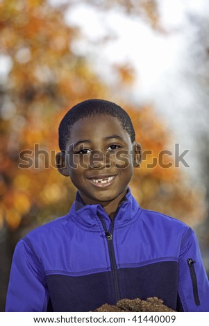 Portrait of an African American male child outdoors in Autumn