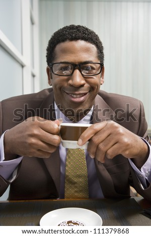 Portrait of an African American man drinking coffee
