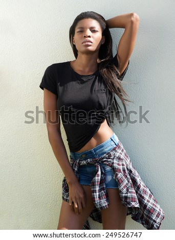 Portrait of an african female fashion model posing with shorts