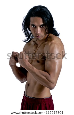 Portrait of an aggressive muscular man over a white background