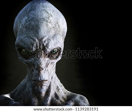 Portrait of an alien male extraterrestrial on a dark background. 3d rendering