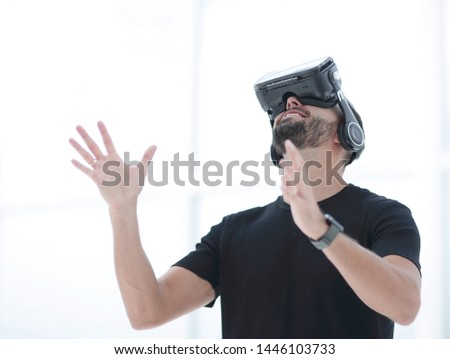 portrait of an amazed guy using a virtual reality headset isolated