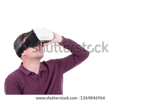 portrait of an amazed man using a virtual reality headset isolated in white background