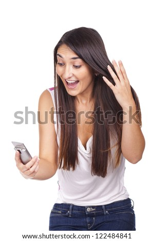 Portrait of an amazed woman reading a text message