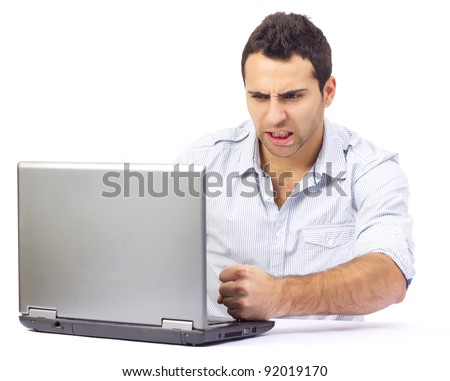 Portrait of an angry business man at his laptop, on white background