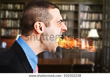 Portrait of an angry businessman spitting fire