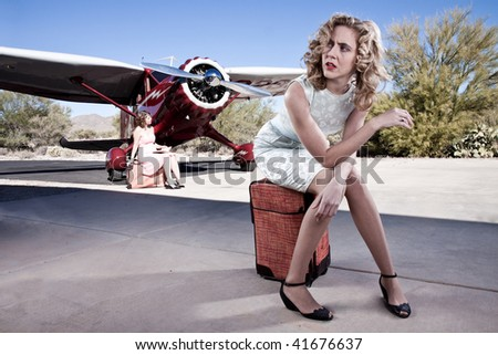Portrait of an annoyed passenger, waiting for her flight. With a classic private plane