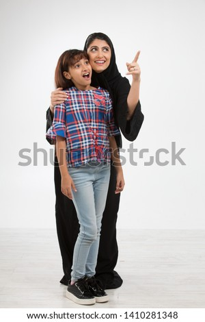 Portrait of an Arab mother and her daughter.