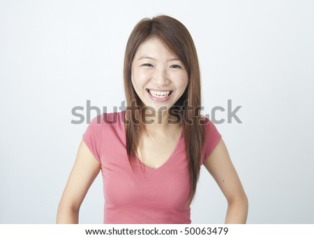 portrait of an asian girl laughing in joy