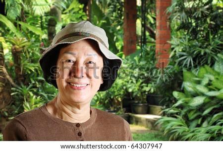 portrait of an Asian lady in a garden