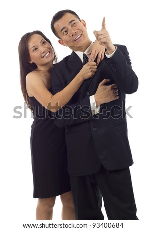 Portrait of an Asian man pointing at something interesting to his wife, girlfriend isolated over white background