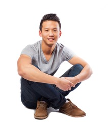 portrait of an asian man posing sitting