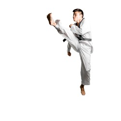 Portrait of an asian professional taekwondo black belt degree (Dan) jumping for kick. Isolated full length on white background with copy space and clipping path