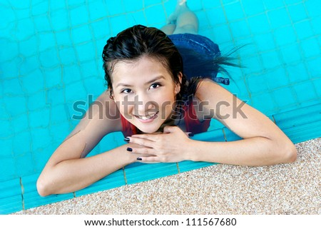 Portrait of an Asian woman in the swimming pool.