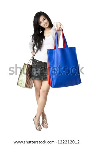 Portrait of an Asian woman with her shopping bags and facing on the camera
