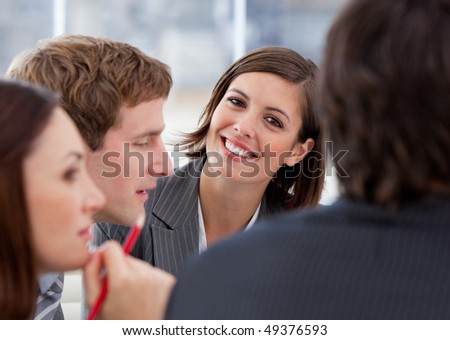 Portrait of an assertive businesswoman and her team in a meeting - stock photo