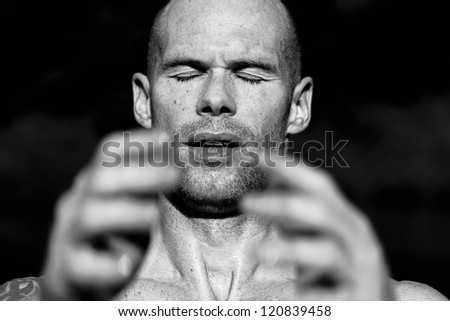 Portrait of an athlete raising his hands in concentration, or at the finish - stock photo