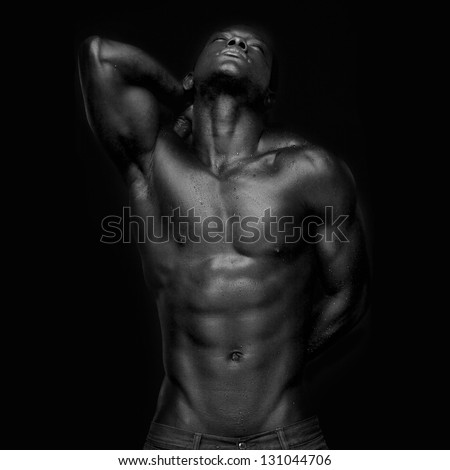 Portrait of an athletic african american looking up - black and white