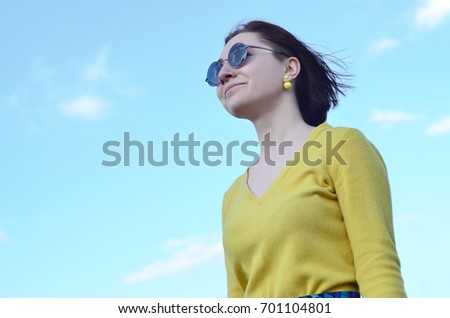 1f7ad27450 Portrait of an attractive and pretty brunette of European appearance in a  bright yellow sweater and