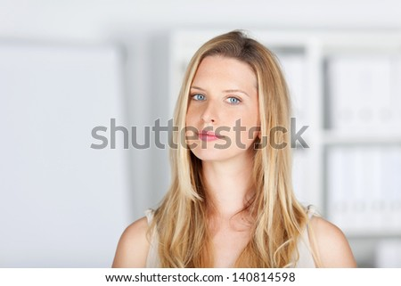 portrait of an attractive blond woman in the office