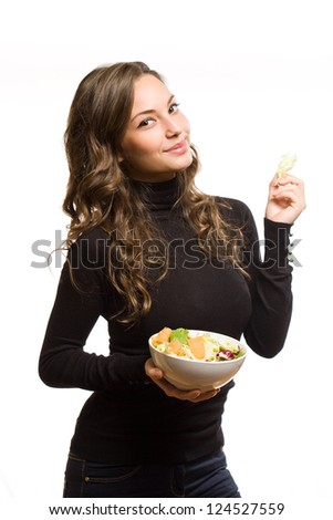 Portrait of an attractive brunette woman with a bowl of salad.