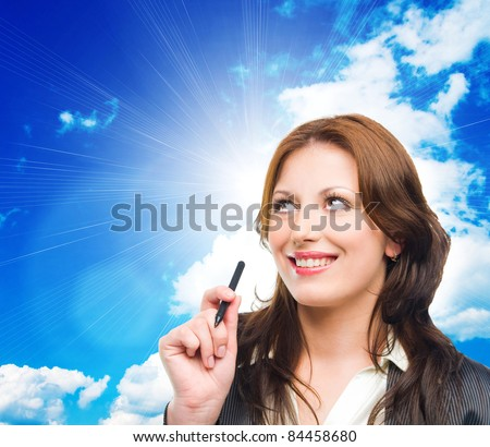 Portrait of an attractive business woman dreaming on blue sky