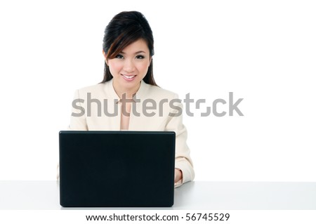 Portrait of an attractive businesswoman using laptop with copy space over white background.