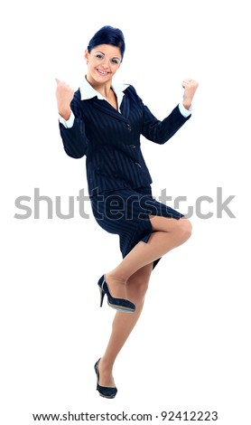 Portrait of an attractive businesswoman with her arms raised in celebration