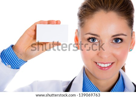 Portrait of an attractive female doctor standing against white background. and holding a business card