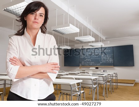 Portrait of an attractive female teacher in a classroom