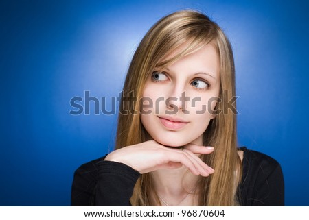 Portrait of an attractive graceful cute young blond woman.
