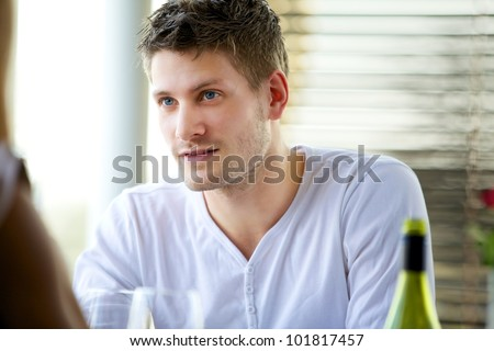 Portrait of an attractive guy seriously listening to someone - stock photo