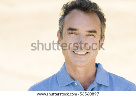Portrait of an Attractive Man Smiling Directly To Camera - stock photo