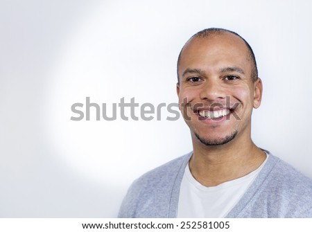 stock-photo-portrait-of-an-attractive-mixed-race-man-smiling-to-camera-252581005.jpg