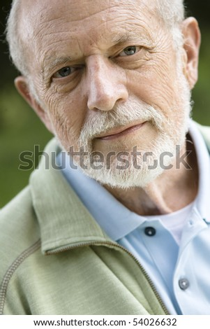 Portrait of an Attractive Old Man with a Beard Looking Directly to the Camera