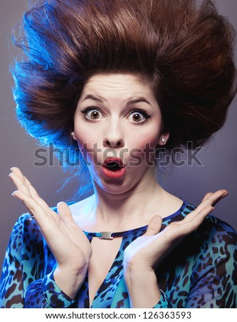 Portrait of an attractive surprised young woman