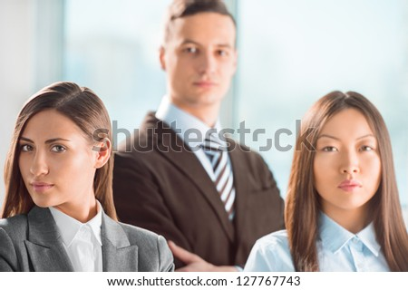 Portrait of an attractive young business group standing together at office